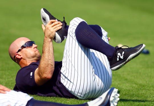 Feb 19, 2019; Tampa, FL, USA; New York Yankees left fielder Brett Gardner (11) stretches during spring training at George M. Steinbrenner Field.