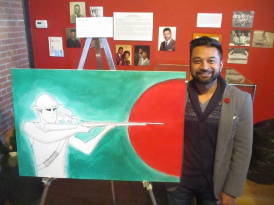 Mir Mahmood displays his painting during a recent event celebrating Bangladeshi culture at the Paterson Museum.