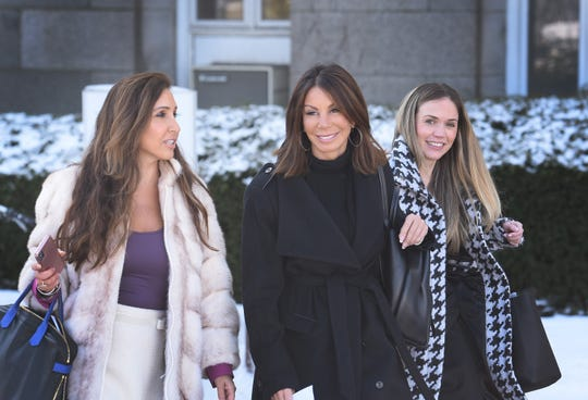 Danielle Staub (center) of RHONJ who is finalized her high-profile divorce from her husband Marty Caffrey, leaves from Bergen County Superior Court following her divorce hearing in Hackensack on 02/21/19. A woman on Left is her attorney.