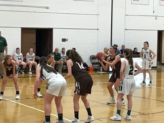 Pascack Hills senior Megan Evans (21) lines up a free throw that will help seal the Cowgirls' 32-27 win over Midland Park in the Bergen County girls basketball invitational semifinals on Friday, Feb. 15, 2019.