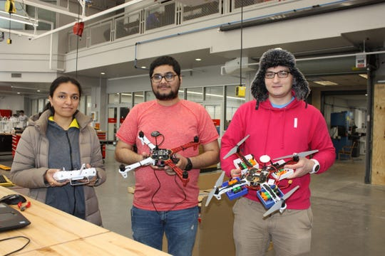 Shruti Kulkarni, Dip Panchal and Piotr Rzymski prepare for the May 1 student drone competition in NJIT's Makerspace.