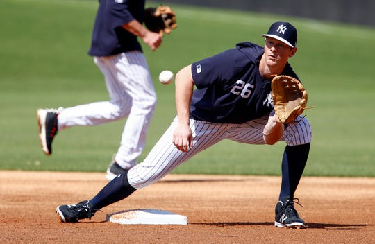 Feb 20, 2019; Tampa, FL, USA; New York Yankees infielder DJ leMahieu (26) catches a ball thrown from home plate in a steal drill during spring training workouts at George M. Steinbrenner Field.