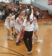 Glen Ridge's Claire McMahon being congratulated by teammates after reaching 1,000 career points.