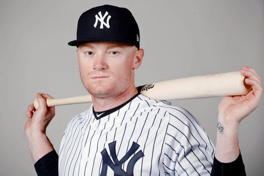 New York Yankees left fielder Clint Frazier (77) poses for a photo on photo day at George M Steinbrenner Field.