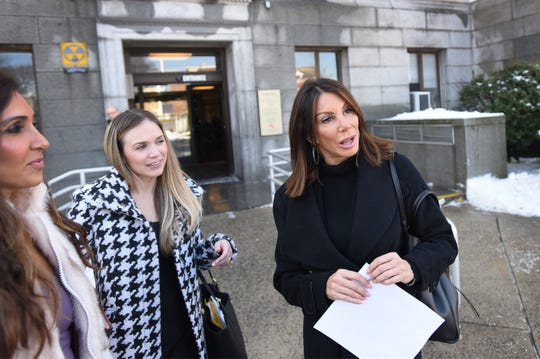 Danielle Staub (R) of RHONJ who is finalized her high-profile divorce from her husband Marty Caffrey, answers questions to the media as she leaves from Bergen County Superior Court following her divorce hearing in Hackensack on 02/21/19.  A woman on Left is her attorney.