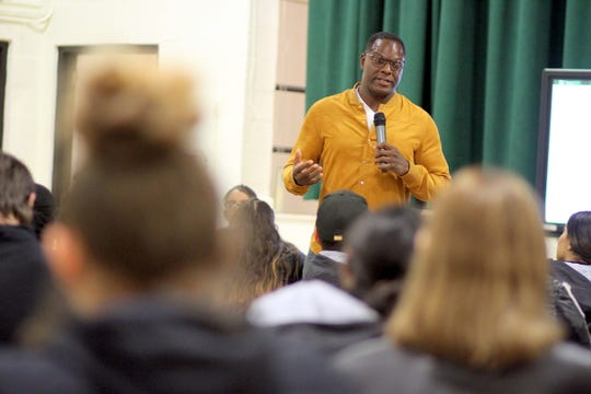"Brian Jones, or ""Uncle Brian"" as he is referred to by Deming Cesar Chavez Charter High School students, addresses the student body during a recent visit."