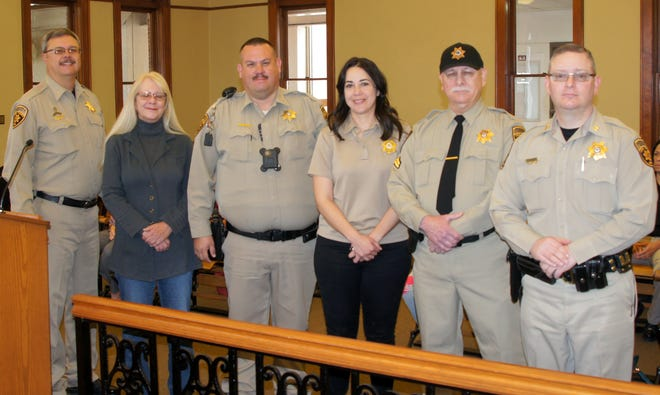 Members of the Luna County Sheriff's Office were recognizes at last weeks Luna County Board of Commissioners Meeting at the historic Luna County Courthouse for years of service to the county. On hand for the presentation was LCSO Sheriff Kelly Gannaway, at left, followed by Deputy Valerie Tyler, 5 years; Deputy Clark Smith, 5 years; Administrative Assistant Laura Garcia, 20 years; Cpl. Mike Eby, 20 years and Capt. Michael Brown, 10 years.
