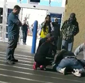 Video shows bystanders detain a stabbing suspect in a Las Cruces Walmart parking lot