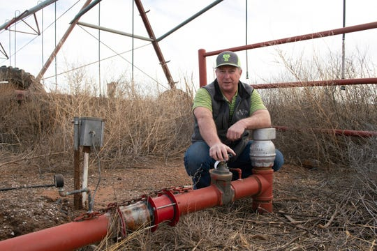 Art Schaap at the most contaminated of his wells, just outside the fence of Cannon Air Force Base in Clovis, New Mexico.