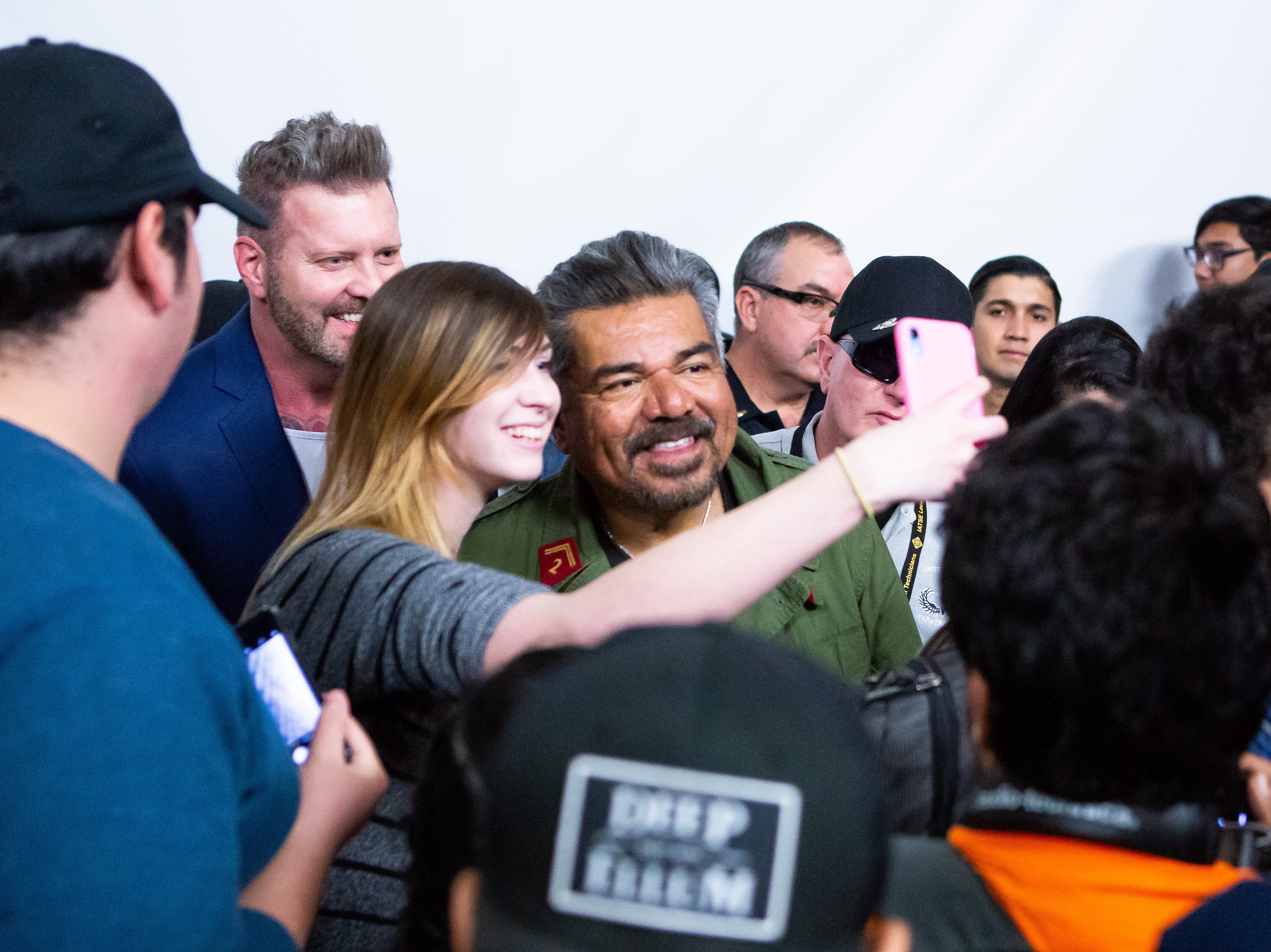 New Mexico State University student Hannah Jackosky takes a selfie with George Lopez on Thursday, Feb. 21, 2019. The actor and comedian spoke with students at Corbett Center Student Union, part of the Las Cruces International Film Festival