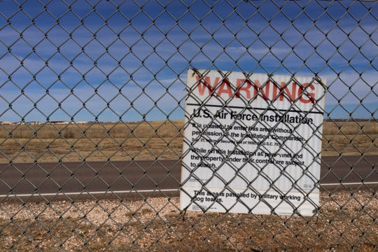 A warning sign is posted on the Cannon Air Force Base fence, bordering the Highland Dairy in Clovis.