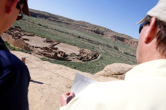 U.S. Department of the Interior Deputy Secretary Mike Connor, left, and New Mexico Sen. Tom Udall, check out a portion of the park while on a hike, Monday, June 29, 2015, at Chaco Culture National Historical Park.