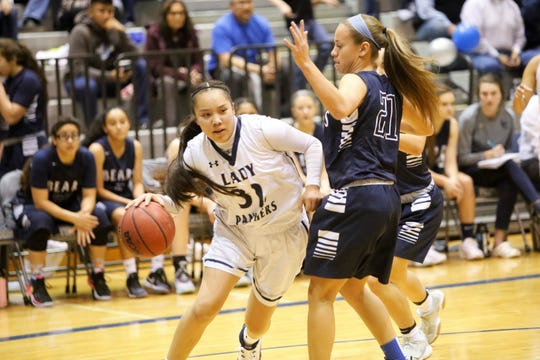 Piedra Vista's Lanae Billy attacks the basket against La Cueva's Deja Sandoval during Wednesday's District 2-5A game at Jerry A. Conner Fieldhouse in Farmington.