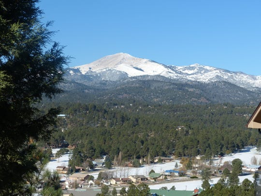 Snow on Sierra Blanca Peak may be refreshed Friday.