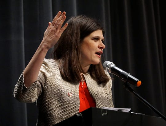 Michigan's 11th District U.S. Congresswoman Haley Stevens addresses a constituents' meeting on Feb. 20 at Milford High School.