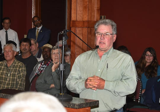 Dwight Landreneau speaks to the St. Landry Parish Council Wednesday night as the representative of an advisory group who supported three introduced ordinances that require a stricter permit application process for companies seeking to place disposal wells on parish property.