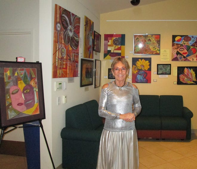 Artist Jean Vezzalini and her colorful artwork.