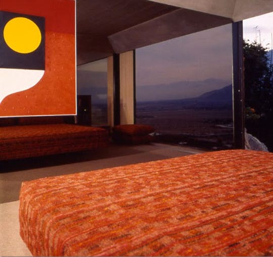 Arthur Elrod's bed in his Southridge home faced a mirrored glass wall with an Andy Nelson painting. The view was reflected in the mirror.