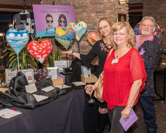 Heart artists Sherri Domenigoni in front and Melody and Gideon Cohn behind.
