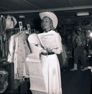 "A model inside Marge Riley Westerns singing ""1200 Miles From Palm Springs to Texas."""