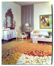 Arthur Elrod's first Palm Springs house on Valmonte Sur. A rare color photo of the living room shows how he's still using some antiques on one side of the room, but the multicolored rug and furniture on the other side are much more contemporary.
