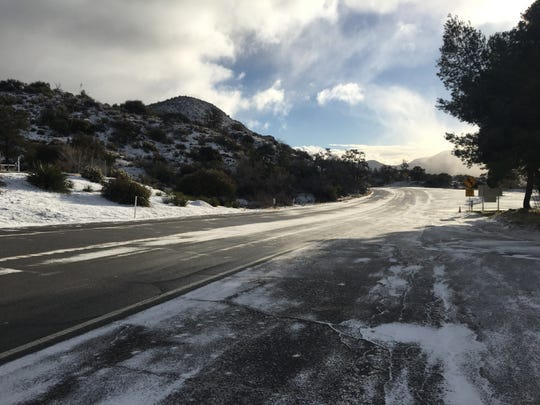 Highway 74 near Sugarloaf Cafe is pictured with snow on the ground. Parts of the highway closed Feb. 21, 2019, due to snow and adverse conditions. Officials allowed residents with tire chains to use the road, however.