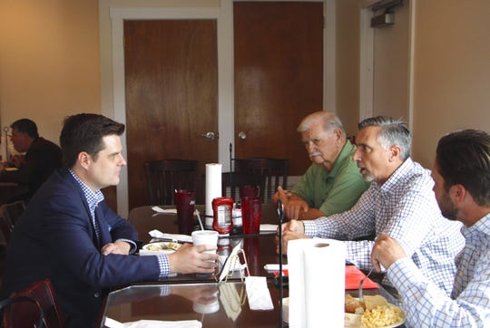 U.S. Rep. Matt Gaetz talks with Jay City Manager Eric Seib, center, Jay Councilman Wayne Godwin, left, and Jay Mayor Shon Owens, right, Thursday at the Royal Café in Jay.