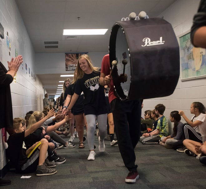 The Gulf Breeze girls soccer team begins their sendoff march starting the elementary school with passes through the middle and high school too, on Thursday, Feb. 21, 2019. The Lady Dolphins are playing in their second state finals match in two-years.