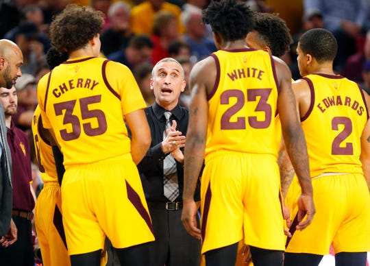 Arizona State head coach Bobby Hurley talks to his team during a break with Stanford during the first half in Tempe Feb. 20, 2019.