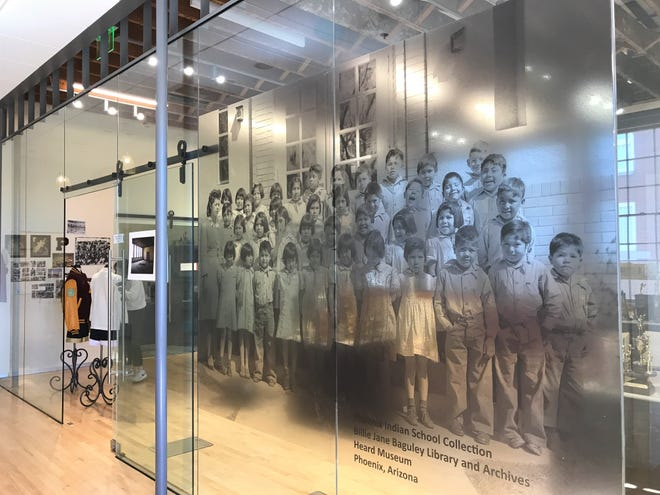 A photo of Native kids from Phoenix Indian School greet people who come into the Phoenix Indian School Visitor Center.