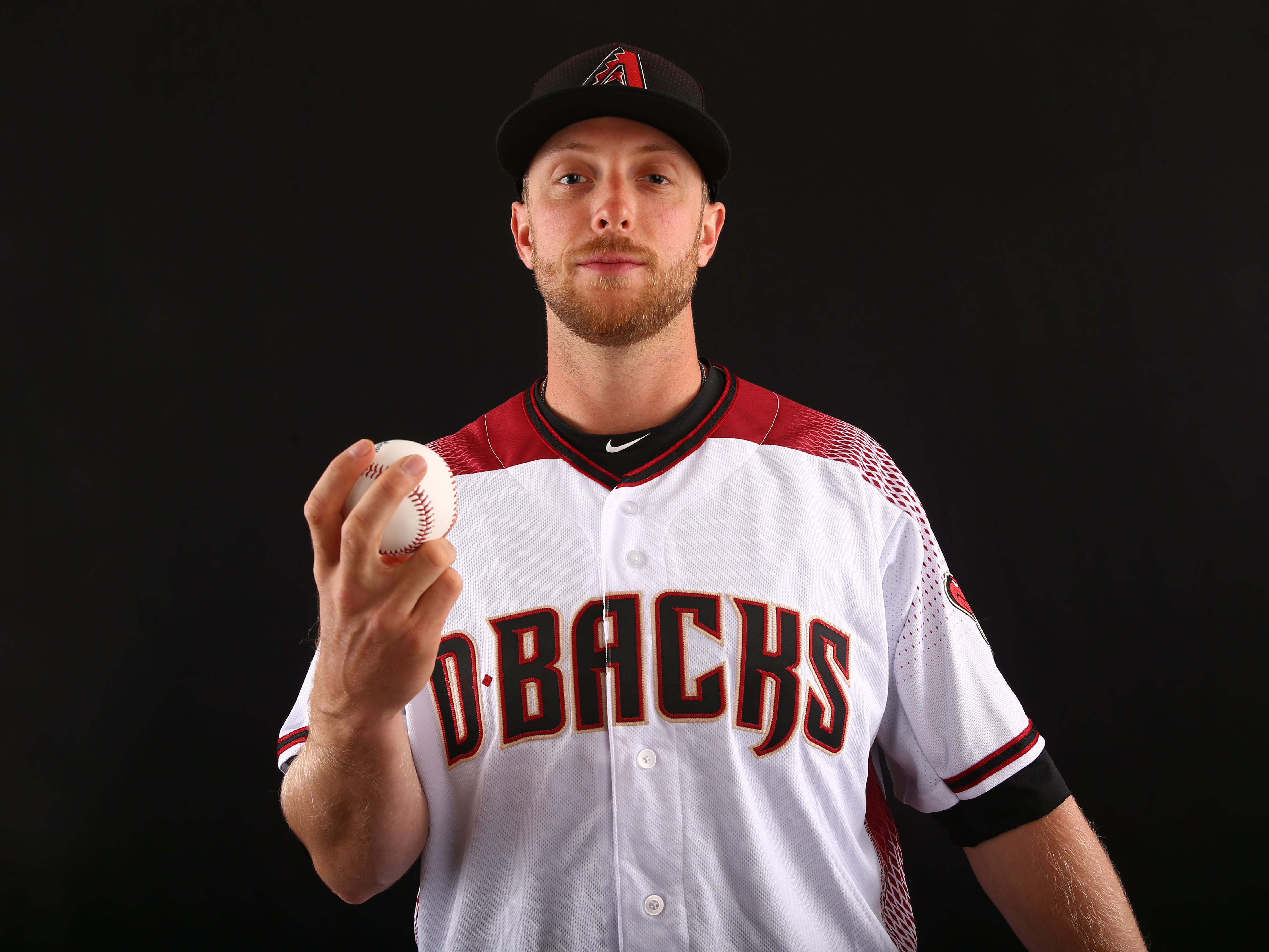 Merrill Kelly of the Arizona Diamondbacks poses for a photo during the annual Spring Training Photo Day on Feb. 20 at Salt River Fields in Scottsdale, Ariz.