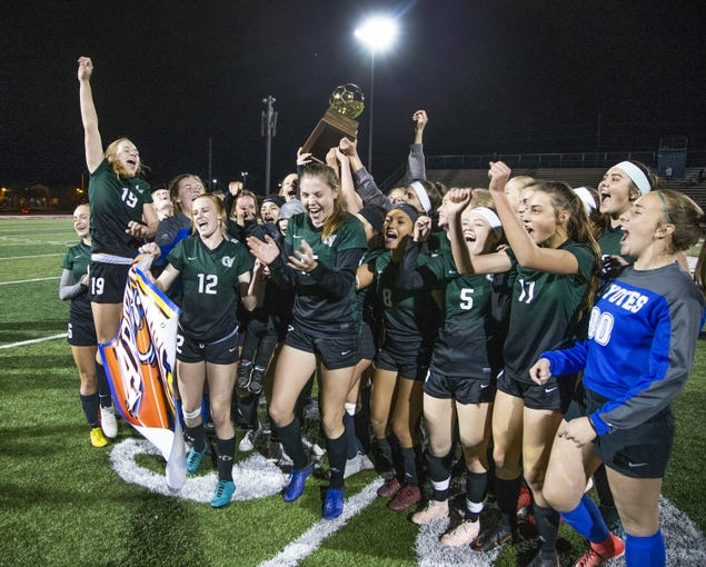 Campo Verde High School soccer players celebrate their victory over Millennium High School in the 5A girls state soccer championship at Coronado High School in Scottsdale on Feb. 20.