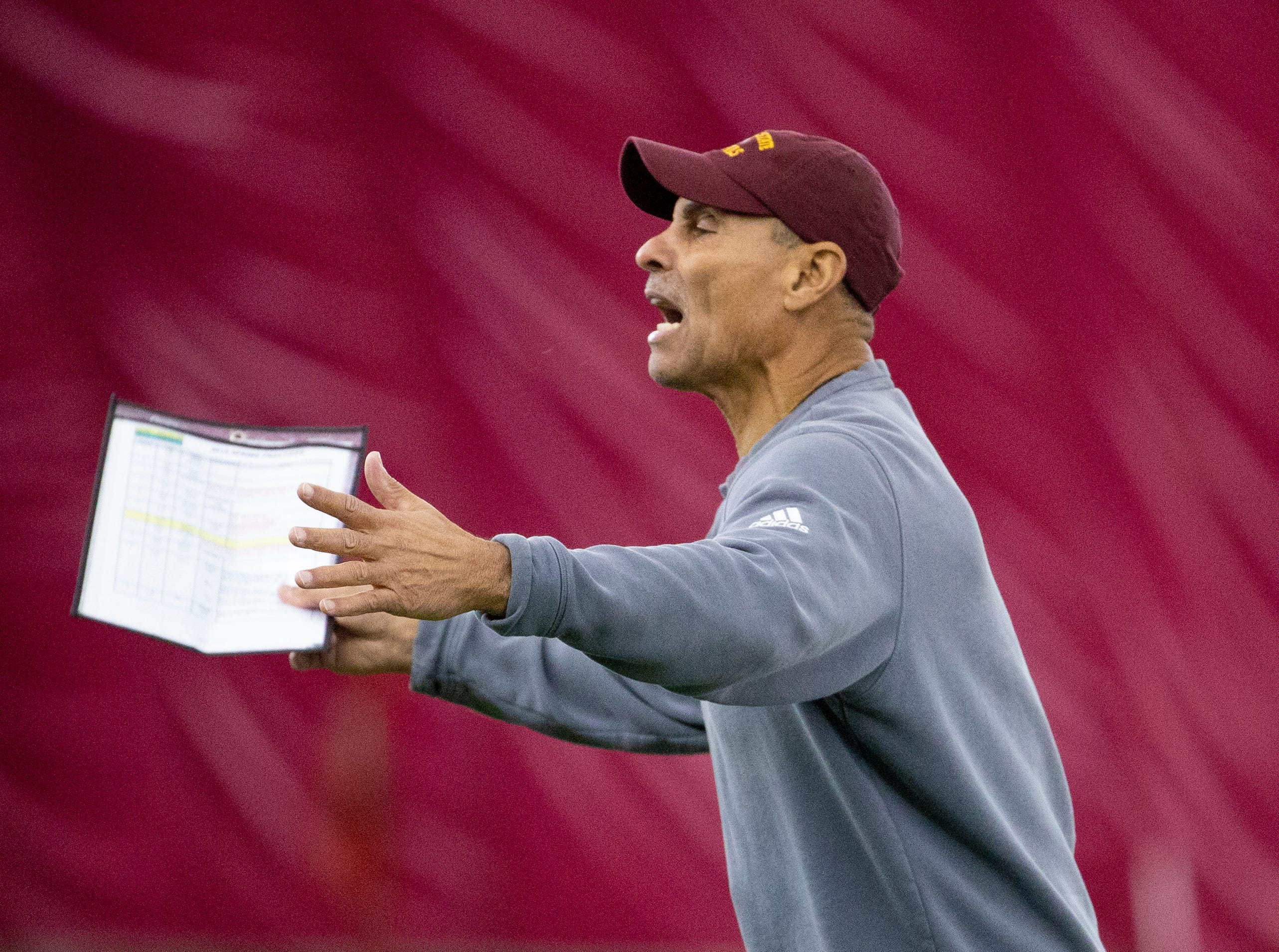 ASU head football coach Herm Edwards coaches his defense during ASU spring football practice in the Verde Dickey Dome in Tempe on February 21.