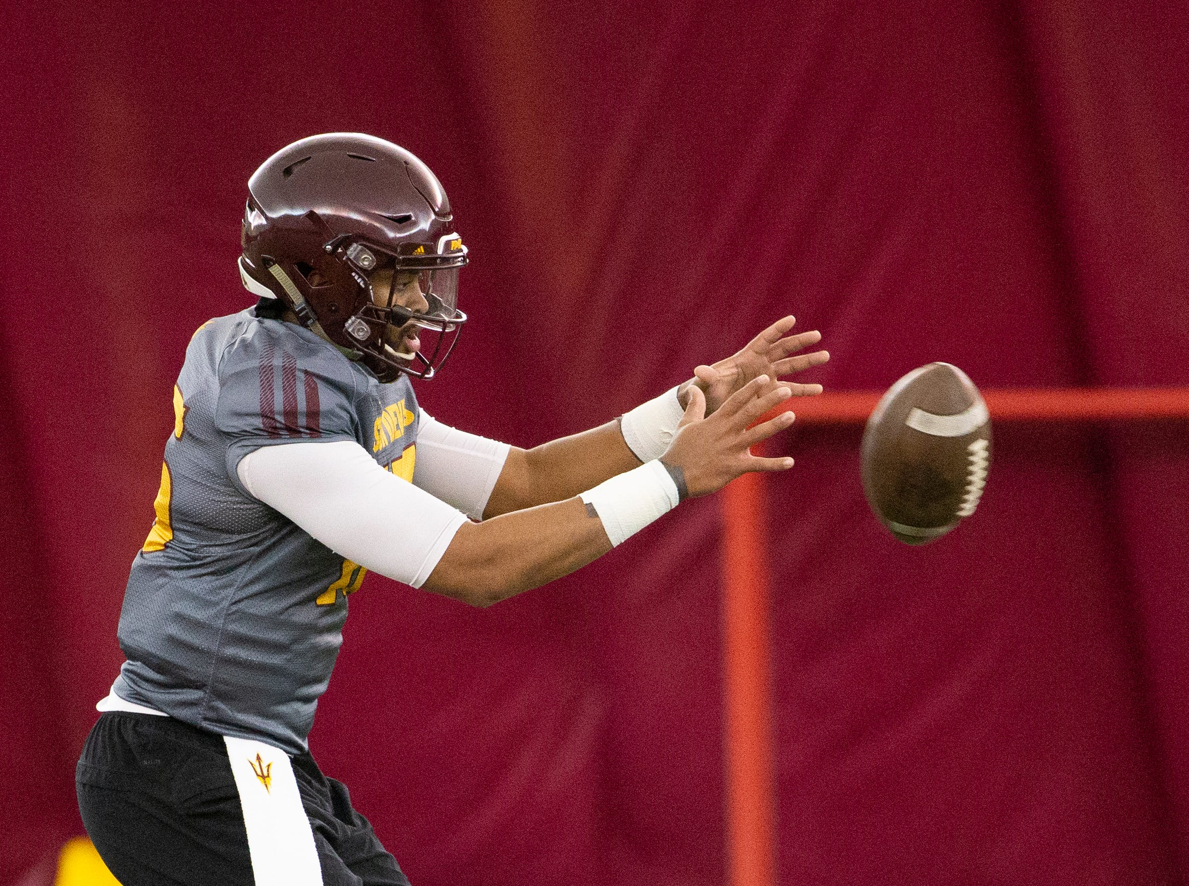 Quarterback  Dillon Sterling-Cole runs a drill during ASU spring football practice in the Verde Dickey Dome in Tempe on February 21.