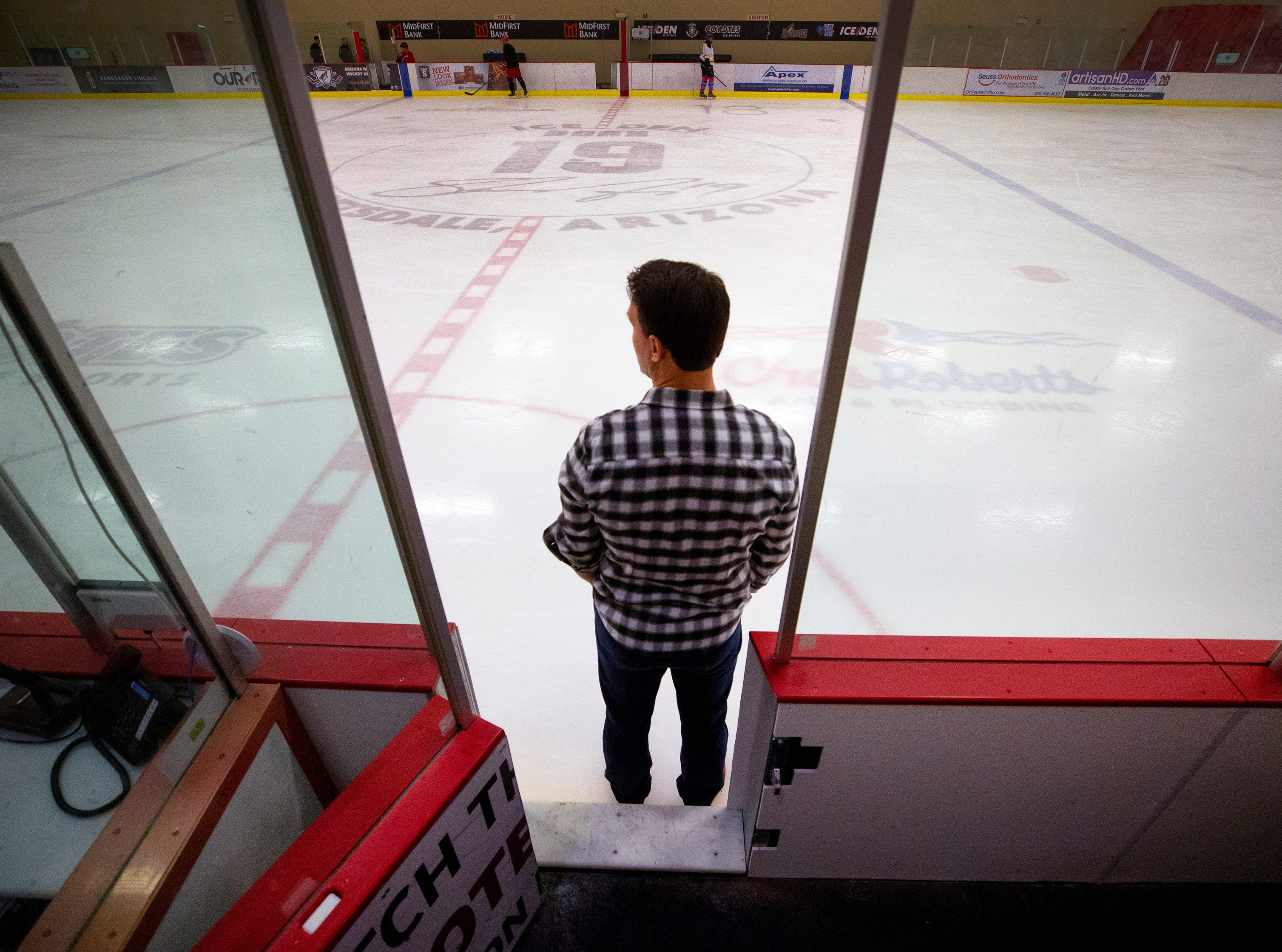 Ex-Coyotes captain Shane Doan looks onto an ice rink named after him at the IceDen Scottsdale ahead of his jersey retirement Sunday, February 24.