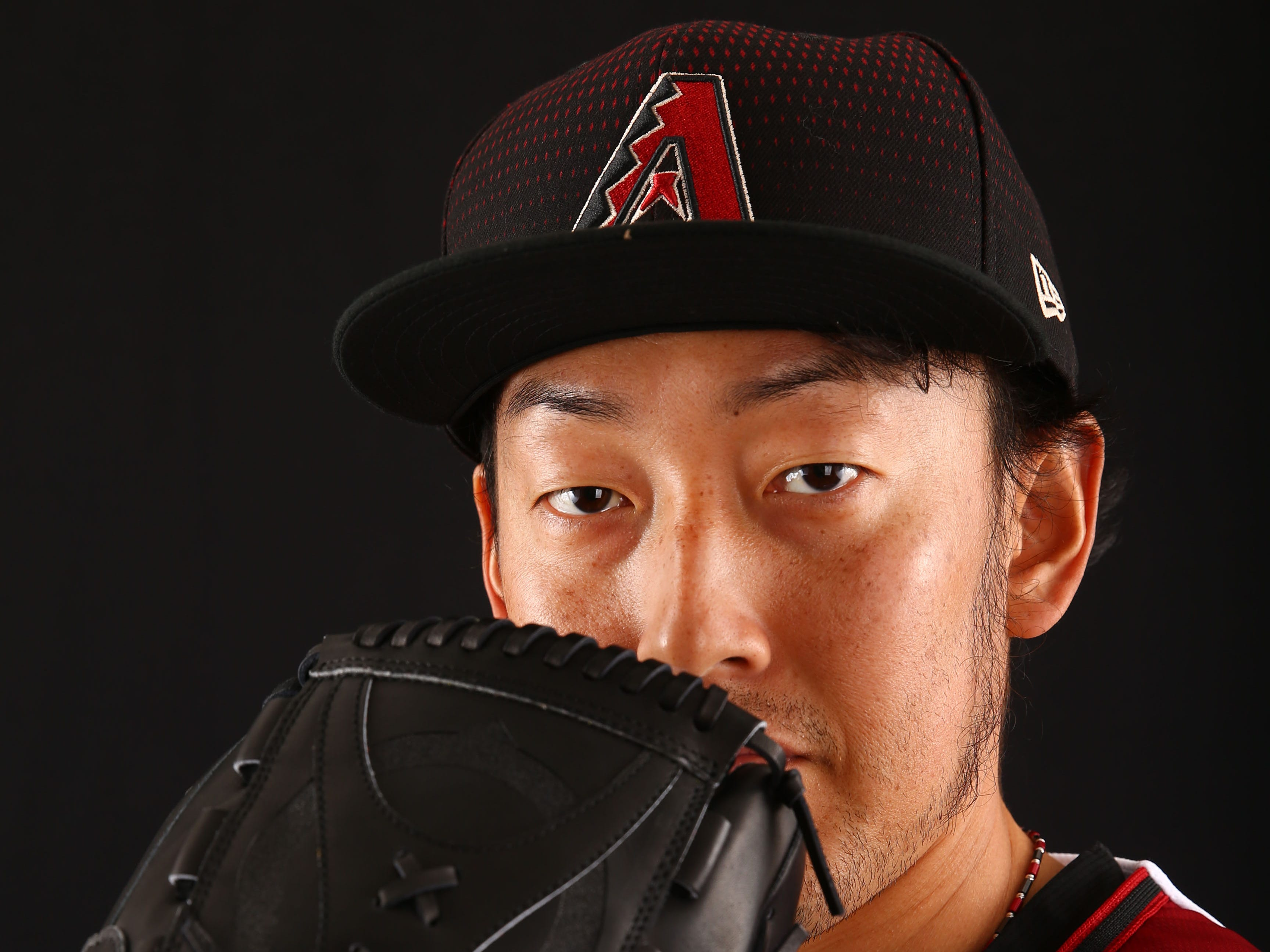 Yoshihisa Hirano of the Arizona Diamondbacks poses for a photo during the annual Spring Training Photo Day on Feb. 20 at Salt River Fields in Scottsdale, Ariz.