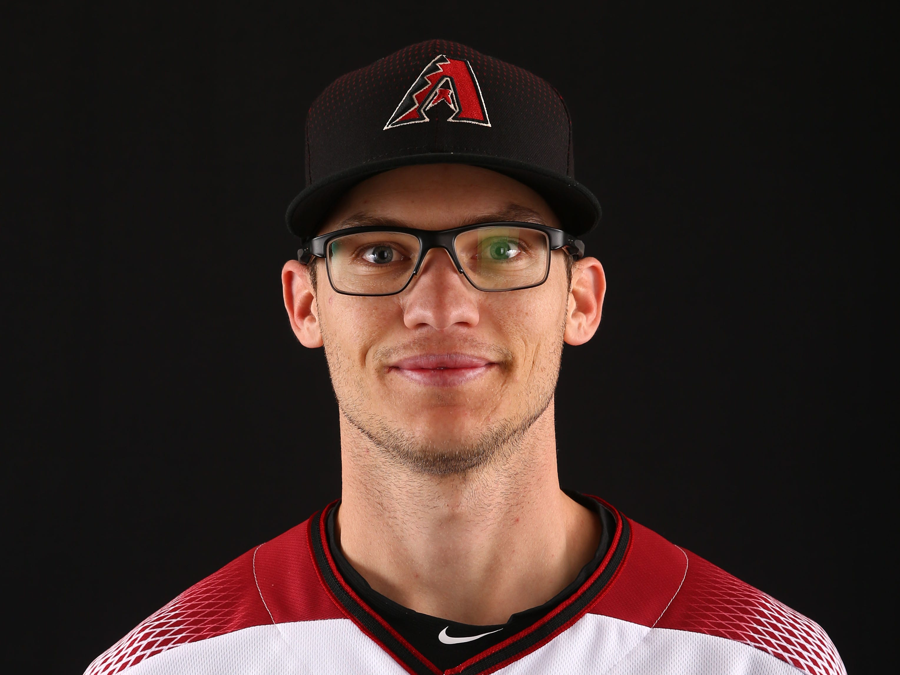 Kelby Tomlinson of the Arizona Diamondbacks poses for a photo during the annual Spring Training Photo Day on Feb. 20 at Salt River Fields in Scottsdale, Ariz.