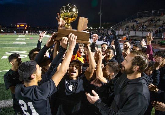Players from Tucson Sunnyside High School celebrate winning the 5A State Soccer Championship by defeating  Campo Verde         High School  4-0 at Coronado High School in Scottsdale, Wednesday, February 20, 2019.