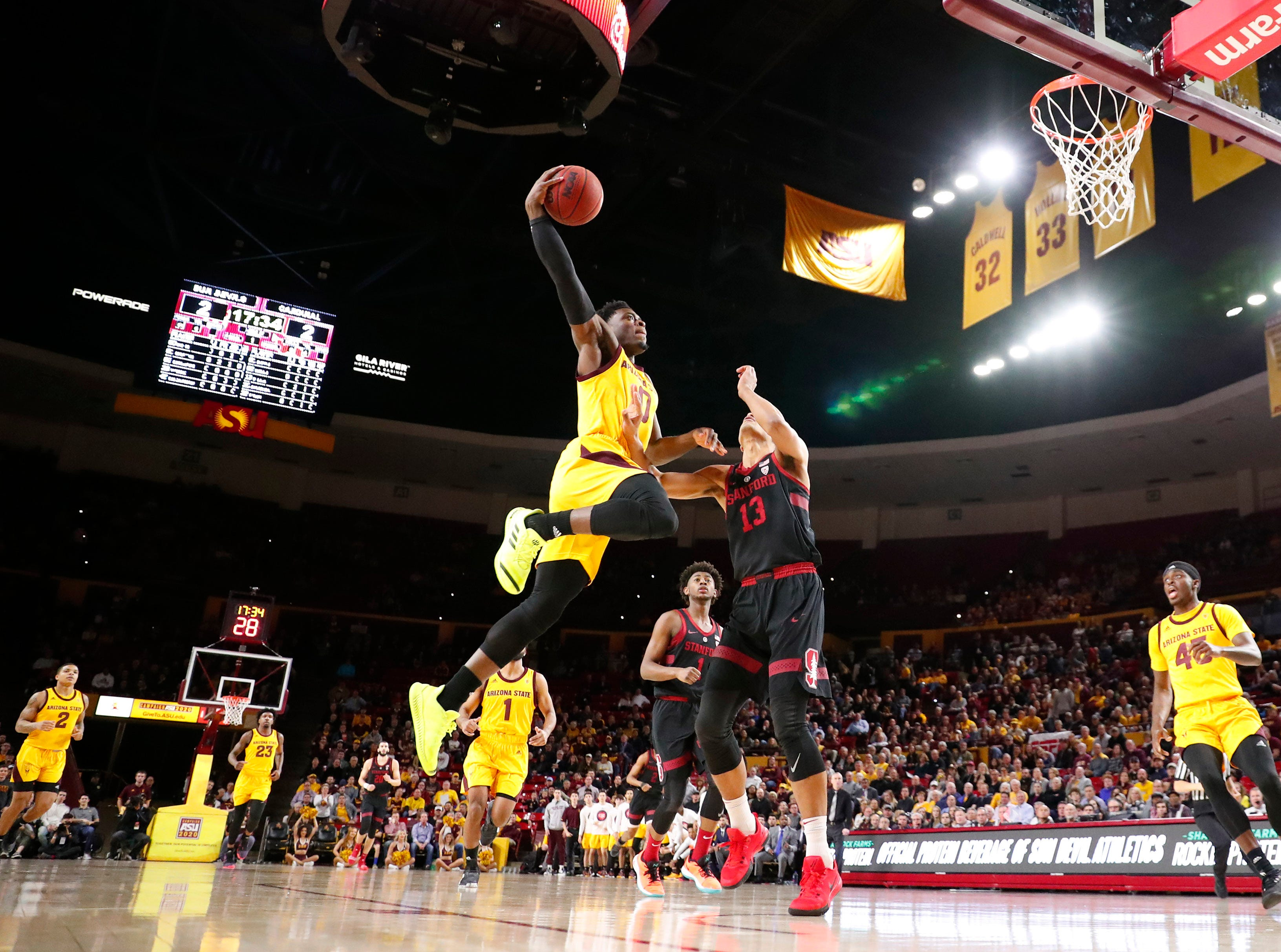 Arizona State guard Luguentz Dort (0) rises up for a dunk against Stanford forward Oscar da Silva (13) during the first half in Tempe Feb. 20, 2019.