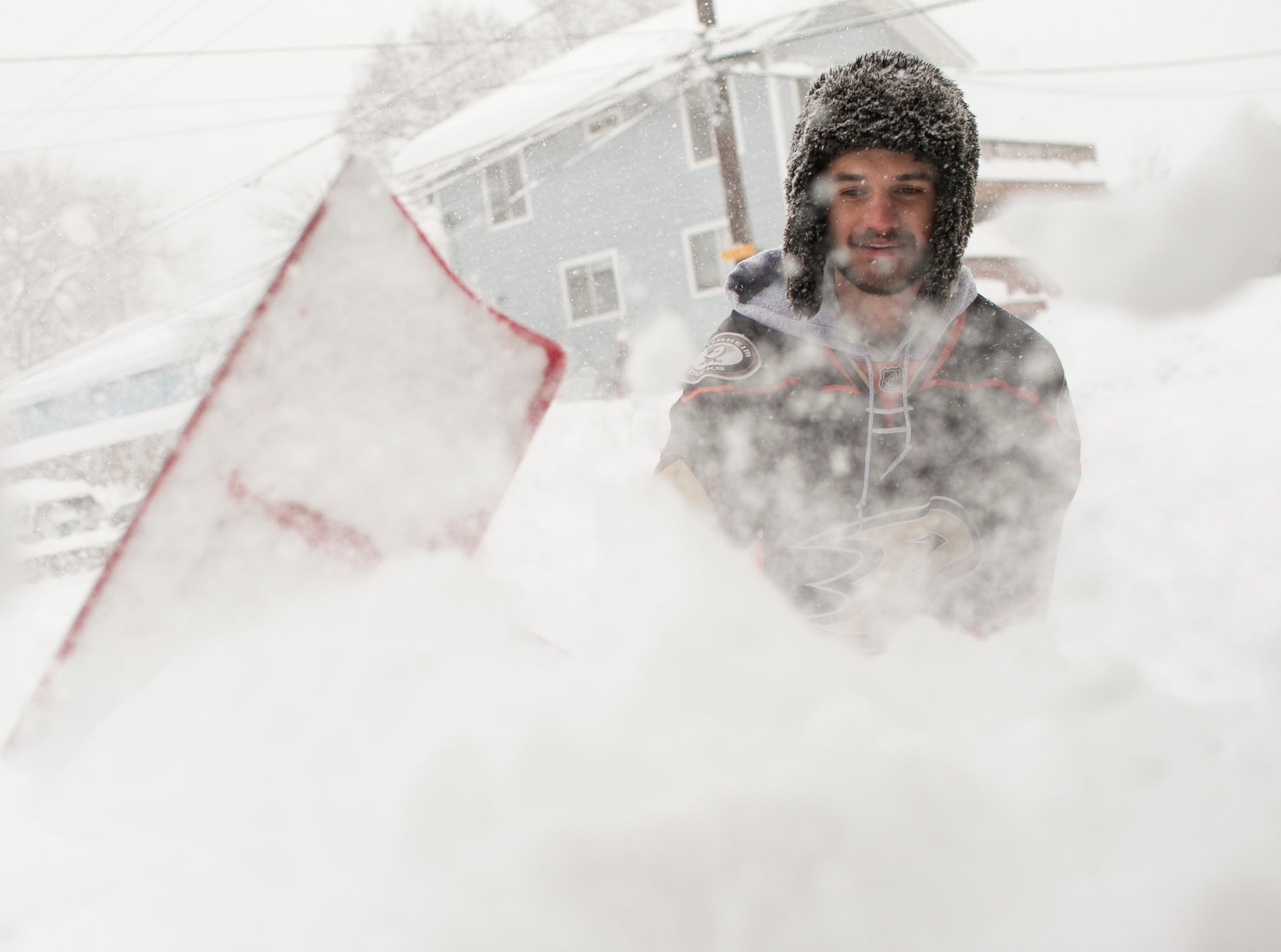 Northern Arizona University student Reid Petersen shovels snow in front of his home in Flagstaff on Feb. 21, 2019. A storm was expected to bring 20-30 inches of snow around northern Arizona through Friday.