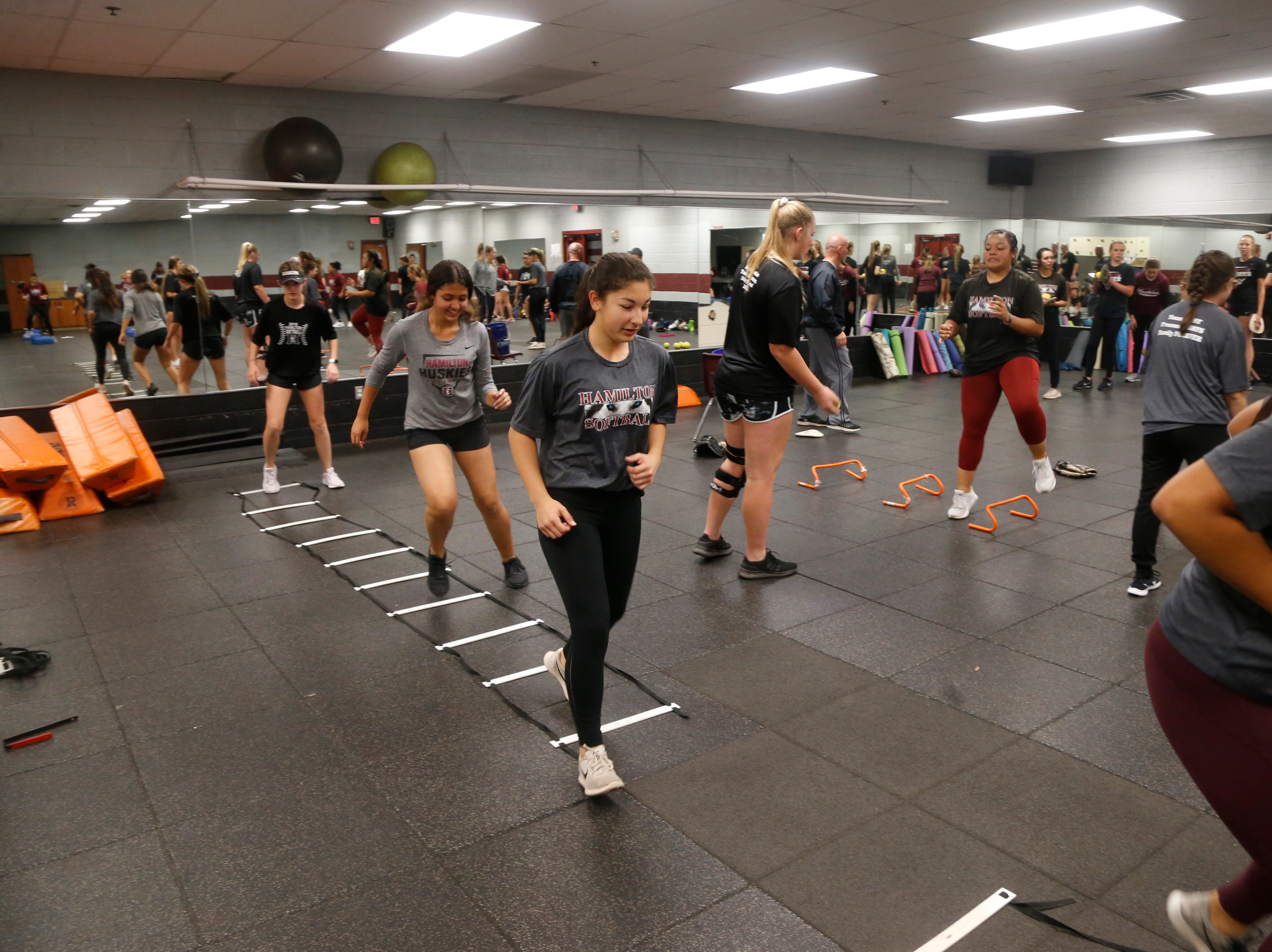 Hamilton softball players practice inside due to rain at Hamilton High School in Chandler, Ariz. on February 21, 2019.