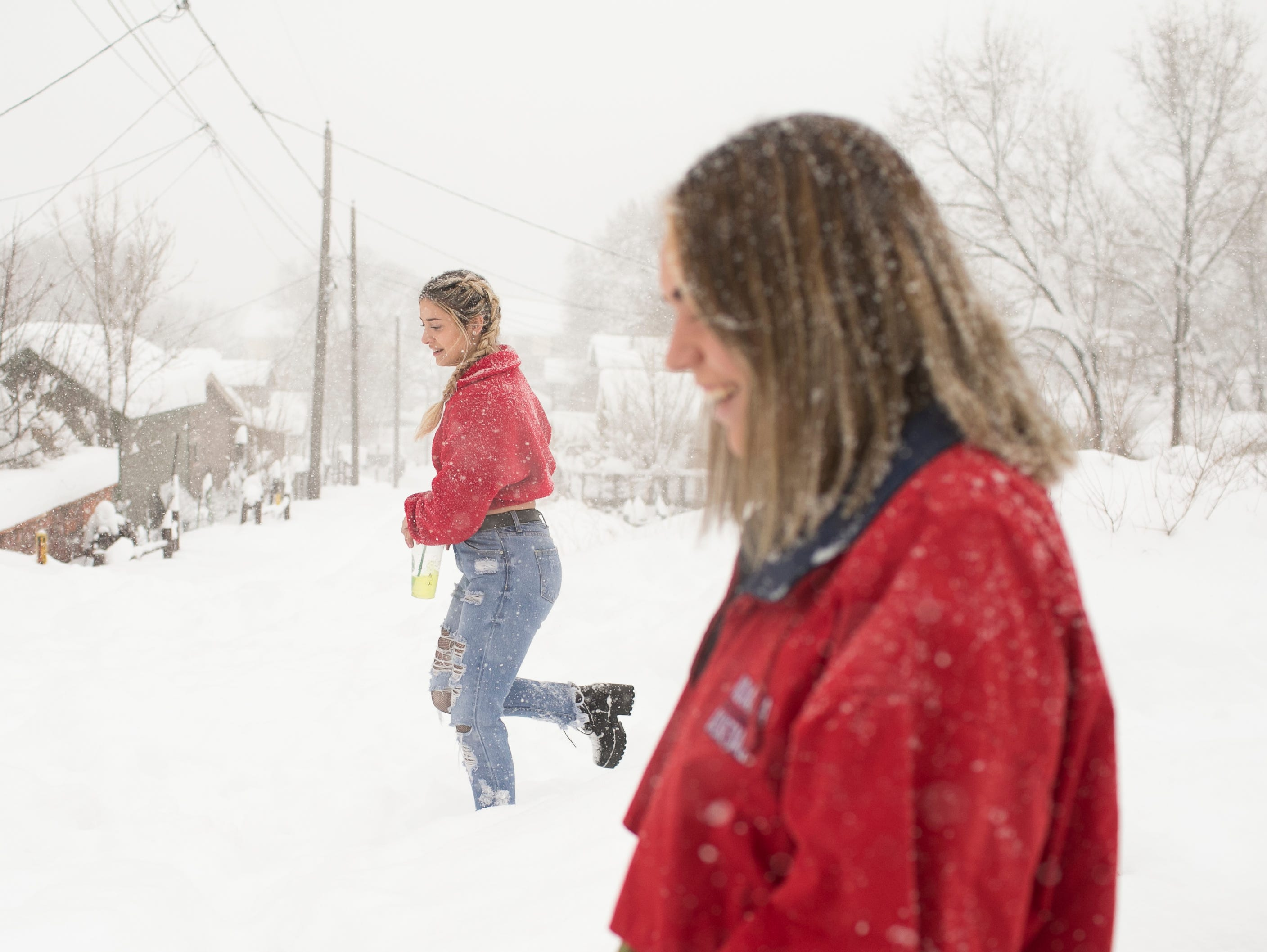 Northern Arizona University students Sierra Nider (left) and Caitlin Callison (right) walk through the snow in Flagstaff on Feb. 21, 2019. A storm was expected to bring 20-30 inches of snow around northern Arizona through Friday.