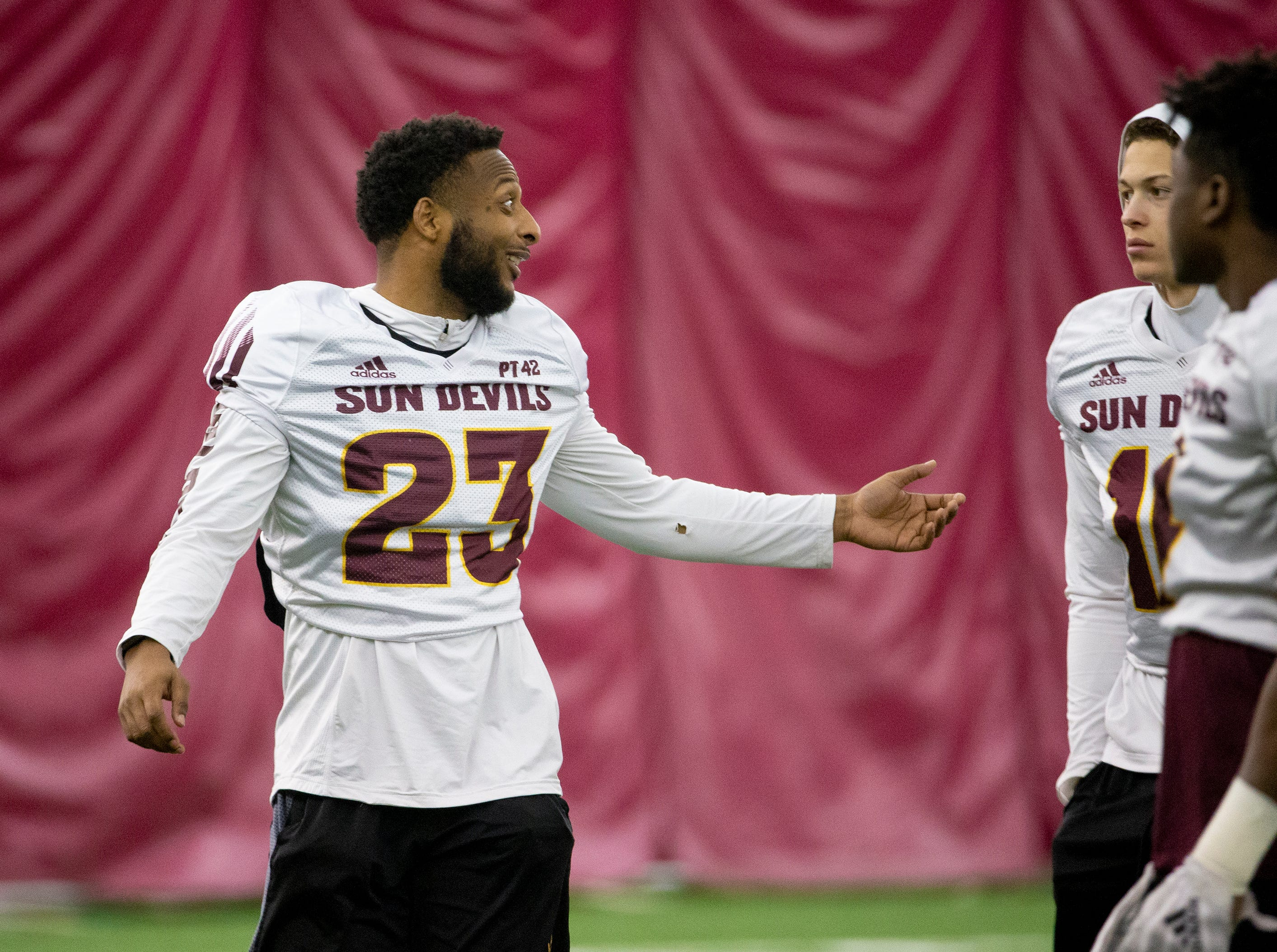 Linebacker Tyler Whiley shares a laugh with his teammates during ASU spring football practice in the Verde Dickey Dome in Tempe on February 21.