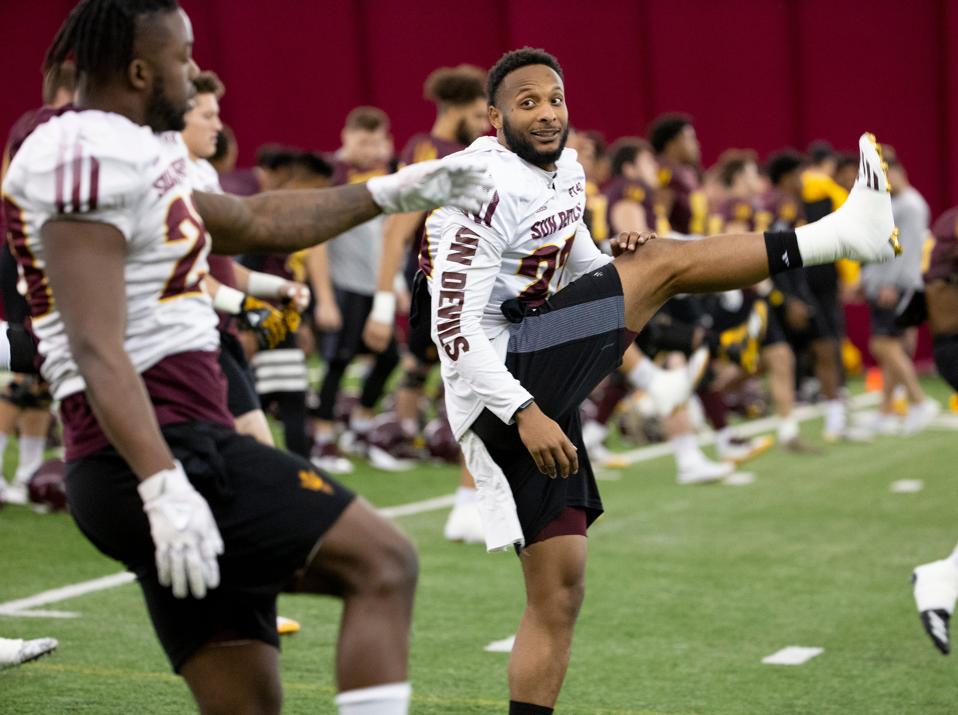 Linebacker Tyler Whiley warms up during ASU spring football practice in the Verde Dickey Dome in Tempe on February 21.