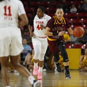 Reili Richardson dribbles up the court during a game against Utah on Feb. 17 at Wells Fargo Arena.