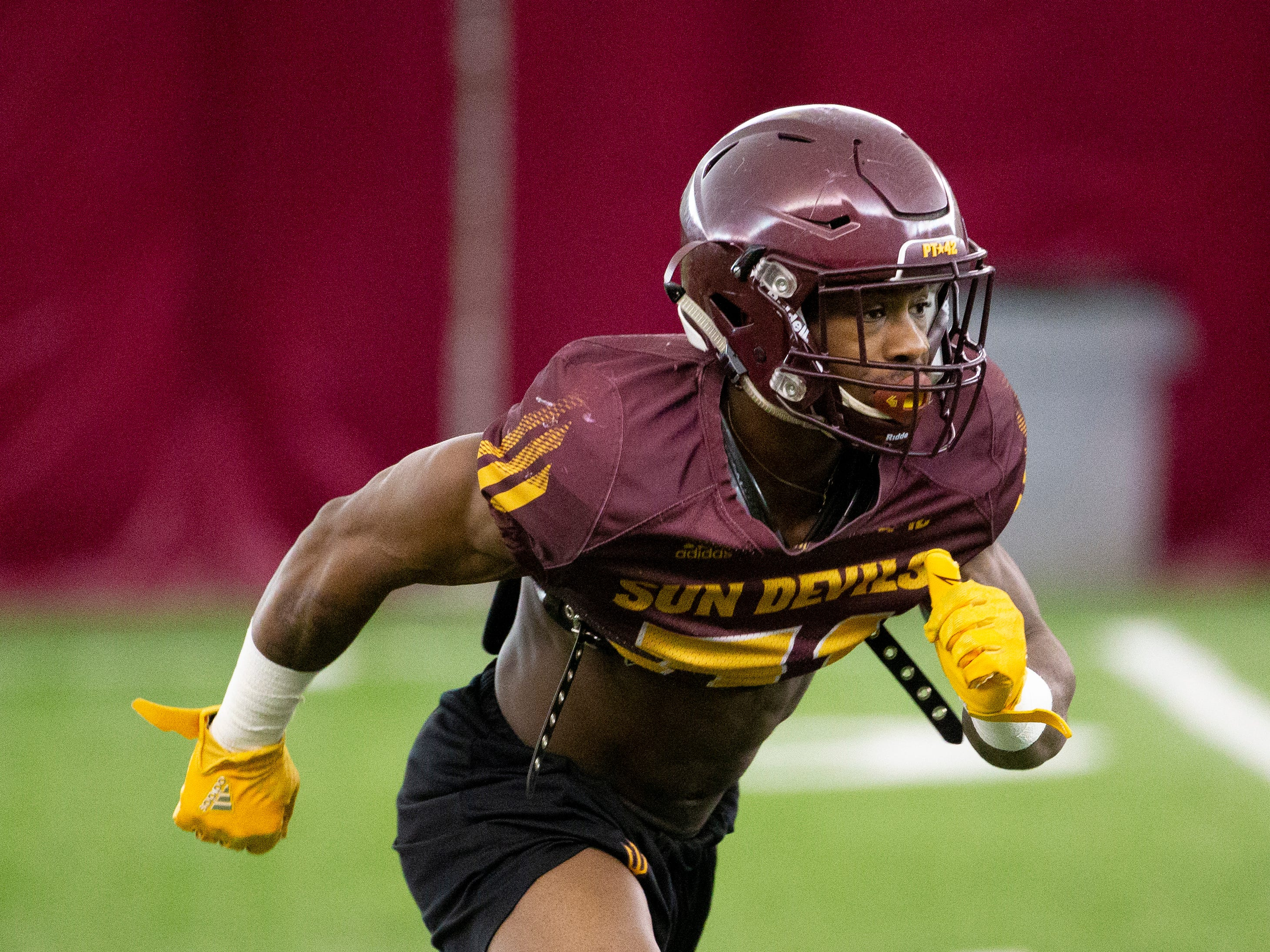 Running back Isaiah Floyd runs a drill during ASU spring football practice in the Verde Dickey Dome in Tempe on February 21.