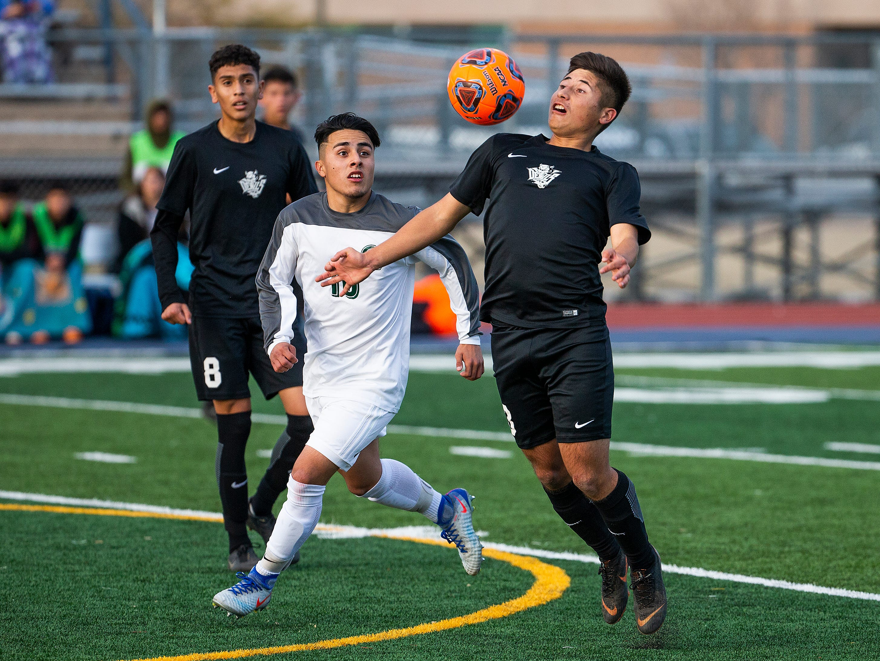 Campo Verde High School player Christian Flores, left, converges on Tucson Sunnyside High School player Juan Correa during the 5A State Soccer Championship at Coronado High School in Scottsdale, Wednesday, February 20, 2019.