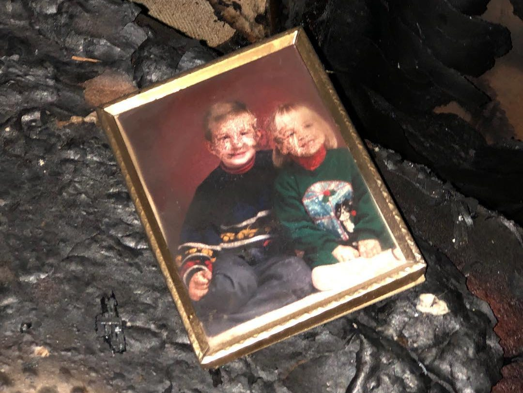 A photo damaged from smoke is one of the few remaining recognizable items from the home of Sally Clark, Rod and Greg Wozniak, which was ravaged by a recent fire.