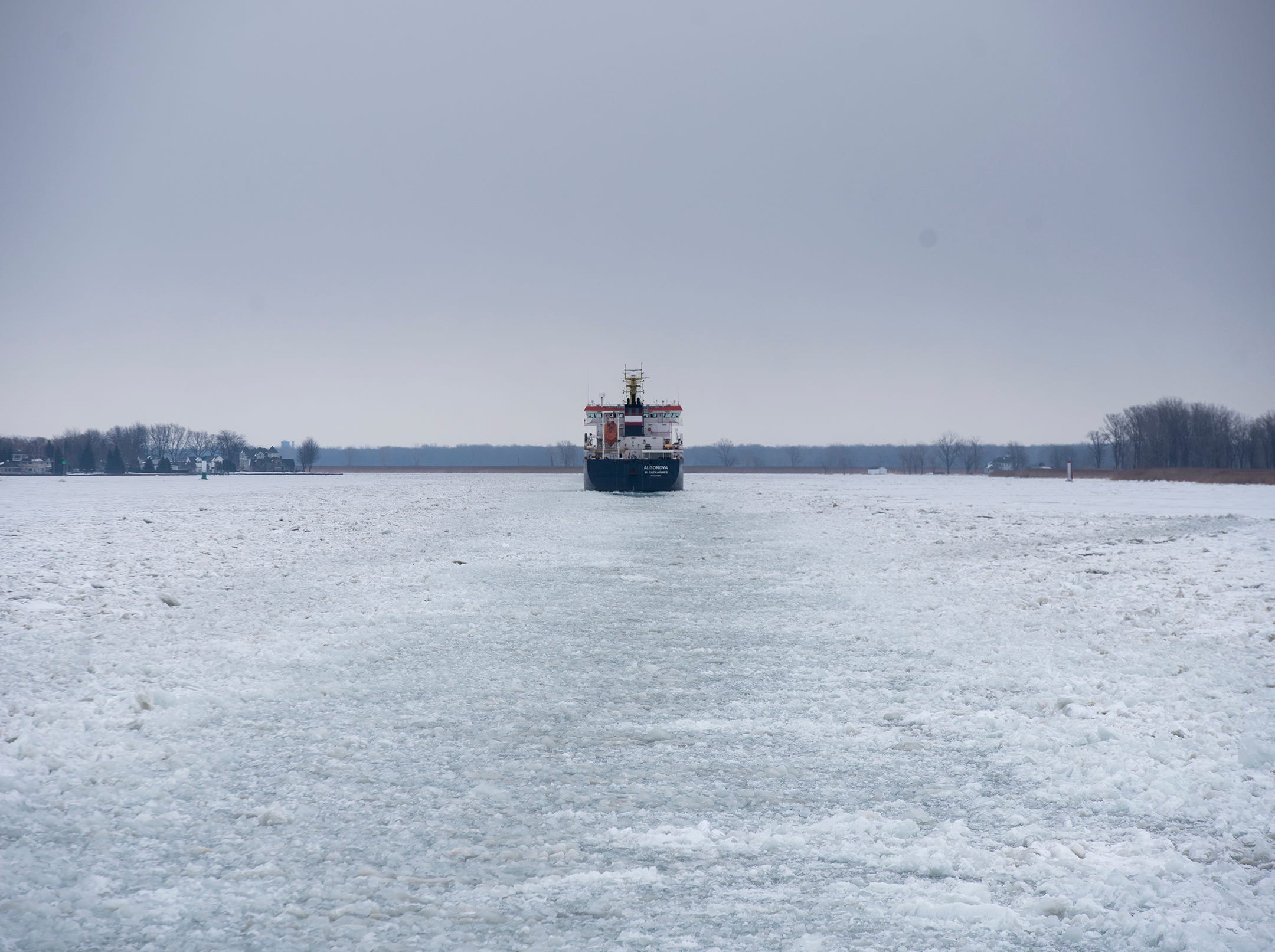 The USCGC Hollyhock follows behind the Algonova as it assists the USCGC Bristol Bay in escorting the nearly 430-foot freighter north through ice on the St. Clair River. The Bristol Bay lead the way, while the Hollyhock brought up the rear. This allows the Hollyhock to go along and free the freighter if it became stuck, which saves time and reduces the risk of either cutter becoming stuck.