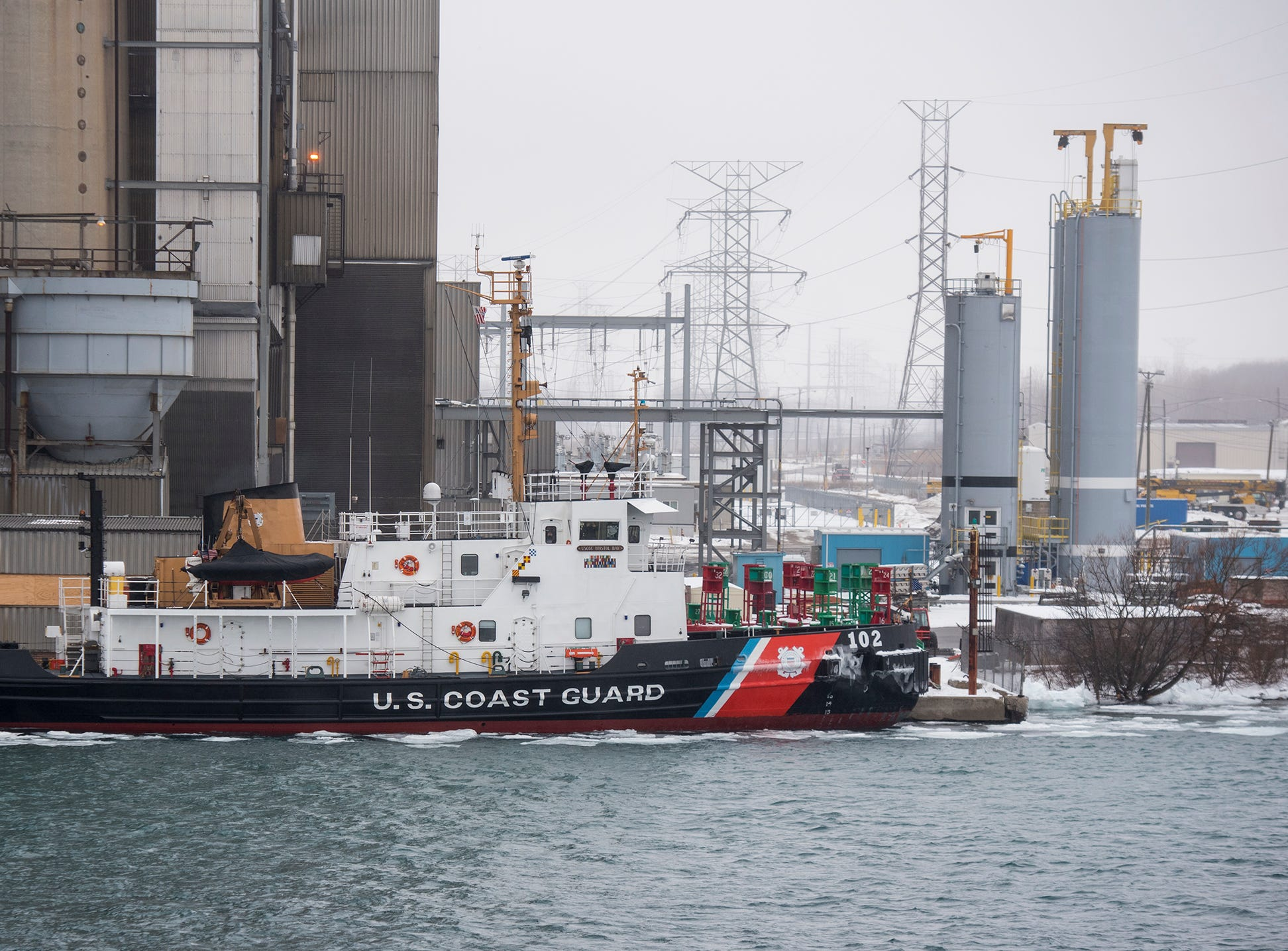 The USCGC Bristol Bay is seen through the fog docked at the DTE Energy plant in East China Wednesday, Feb. 20, 2019, after successfully helping to guide the Algonova through the ice.